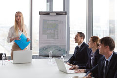 Business woman presenting project to her colleagues Royalty Free Stock Photo