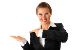 Business woman presenting something on empty hand. Smiling modern business woman presenting something on empty hand isolated on white Stock Photography