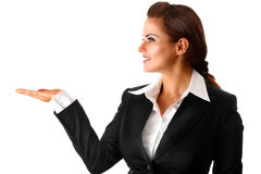 Business woman presenting something on empty hand Royalty Free Stock Image