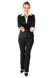 Business woman presenting something on empty hands. Full length portrait of smiling business woman presenting something on empty hands isolated on white Royalty Free Stock Photos