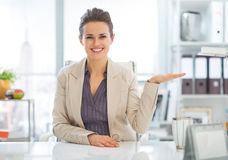 Business woman presenting something on empty palm Stock Images