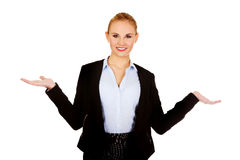Business woman presenting something on open palms Royalty Free Stock Image