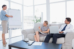 Business woman presenting something on a whiteboard Royalty Free Stock Photos