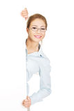 Business woman presenting your product. Stock Photo