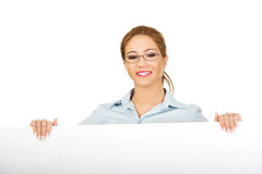 Business woman presenting your product. Royalty Free Stock Photo