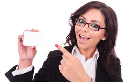 Business woman presents card Stock Photo
