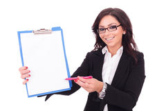 Business woman presents clipboard Royalty Free Stock Photos