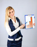 Business woman presents the company's revenue in the graph on the tablet Stock Images