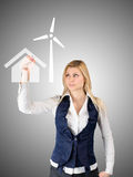 Business woman presents the future of the house with self-contained power consumption Royalty Free Stock Photography