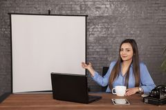 Business woman presents a place on your advertisement stock photo