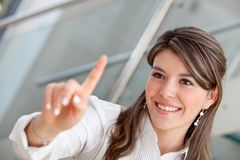 Business woman pressing a button Royalty Free Stock Photography