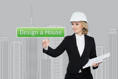 Business woman pressing desing a hause button on virtual screens. Residential Blocks. Business, technology, internet and Stock Photography