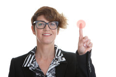 Business woman pressing red button Royalty Free Stock Images