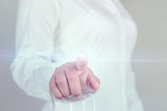 Business woman pressing touch screen Stock Photo