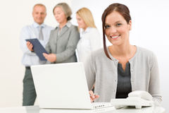 Business woman pretty with colleagues discussing Royalty Free Stock Images