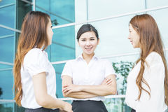 Business woman. Pretty diverse young business women team at office building Royalty Free Stock Images