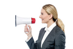 Business woman proclaiming into megaphone Royalty Free Stock Images