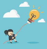 Business woman pulling bulb with rope Royalty Free Stock Photo