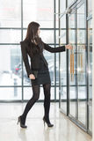 Business woman pulling the door handle Royalty Free Stock Photography