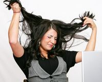Business woman pulling her hair out Royalty Free Stock Photography