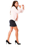 Business woman pulling imaginary rope Stock Photo