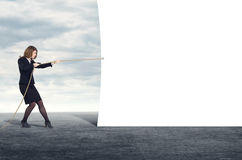 Business woman pulling the rope blank banner Stock Photo