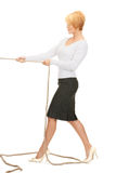 Business woman pulling rope. Bright picture of business woman pulling rope Royalty Free Stock Photos