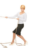 Business woman pulling rope Stock Image