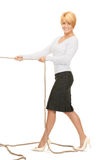 Business woman pulling rope Stock Photo