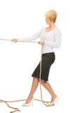 Business woman pulling rope Royalty Free Stock Image