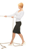 Business woman pulling rope Stock Images