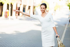 Business woman pulling suitcase bag walking in city Royalty Free Stock Photos