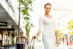 Business woman pulling suitcase bag walking in city Stock Image