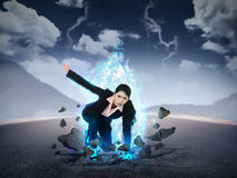 Business woman punch the road with blue fire power Royalty Free Stock Image