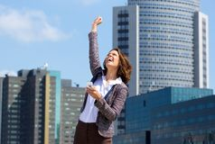 Business woman punching the air with joy. Portrait of a business woman punching the air with joy after reading text message Stock Image