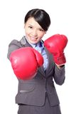 Business woman punching by boxing gloves Stock Photo