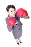Business woman punching by boxing gloves Stock Image