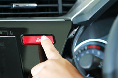 Business woman push emergency button in car Stock Image