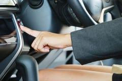 Business woman push an engine start button Stock Photo