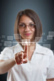 Business woman push high tech type Stock Images