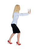 Business woman push something Stock Image