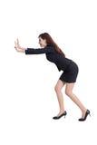 Business woman push something Royalty Free Stock Photo