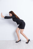 Business woman push something Royalty Free Stock Image