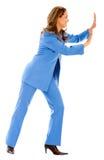 Business woman pushing Stock Photography