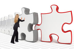 Business woman pushing big puzzle Royalty Free Stock Photo