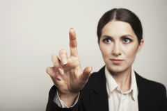 Business woman pushing button face blur isolated Royalty Free Stock Images