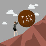 Business woman pushing heavy tax uphill Royalty Free Stock Photo