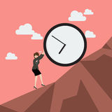 Business woman pushing huge clock uphill Royalty Free Stock Photos