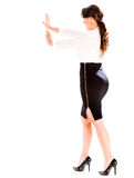 Business woman pushing an object Royalty Free Stock Photography