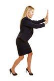 Business woman pushing imaginary wall royalty free stock photos
